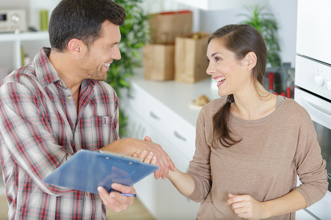restoration contractor shaking hands with woman